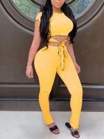 Dreamy Yellow High Rise Pants And Front Knot Crop Top For Walking