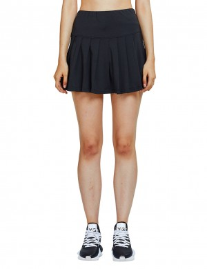 Running Black Plain Pleated Skirt With Packet Shorts For Ladies