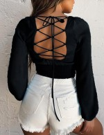 Upscale Black Lace Up Long Sleeve Smocking Cropped Top For Stunner